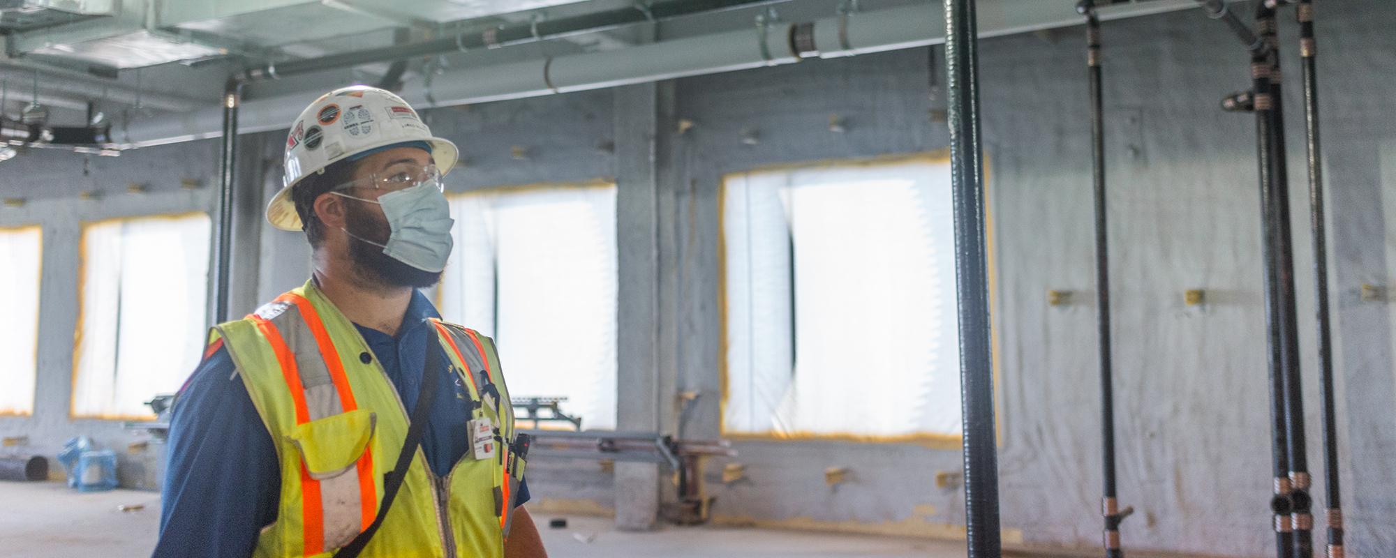 construction worker inspecting installation