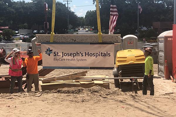 raising a beam on a construction site